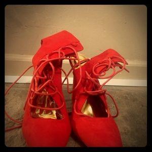 Red suede tie up high heels